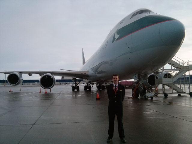 FTA pilot graduate James Grabham in front of Cathay Pacific plane